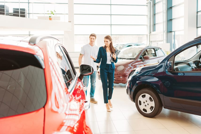 Man shopping for a new car. Here are some money saving tips when car shopping