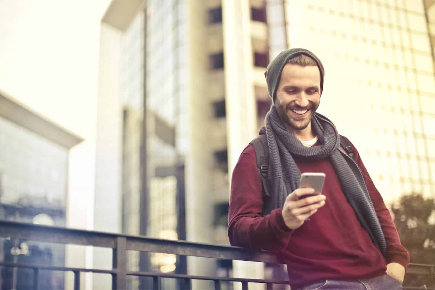 Man Reading an Ally Bank Review on His Phone