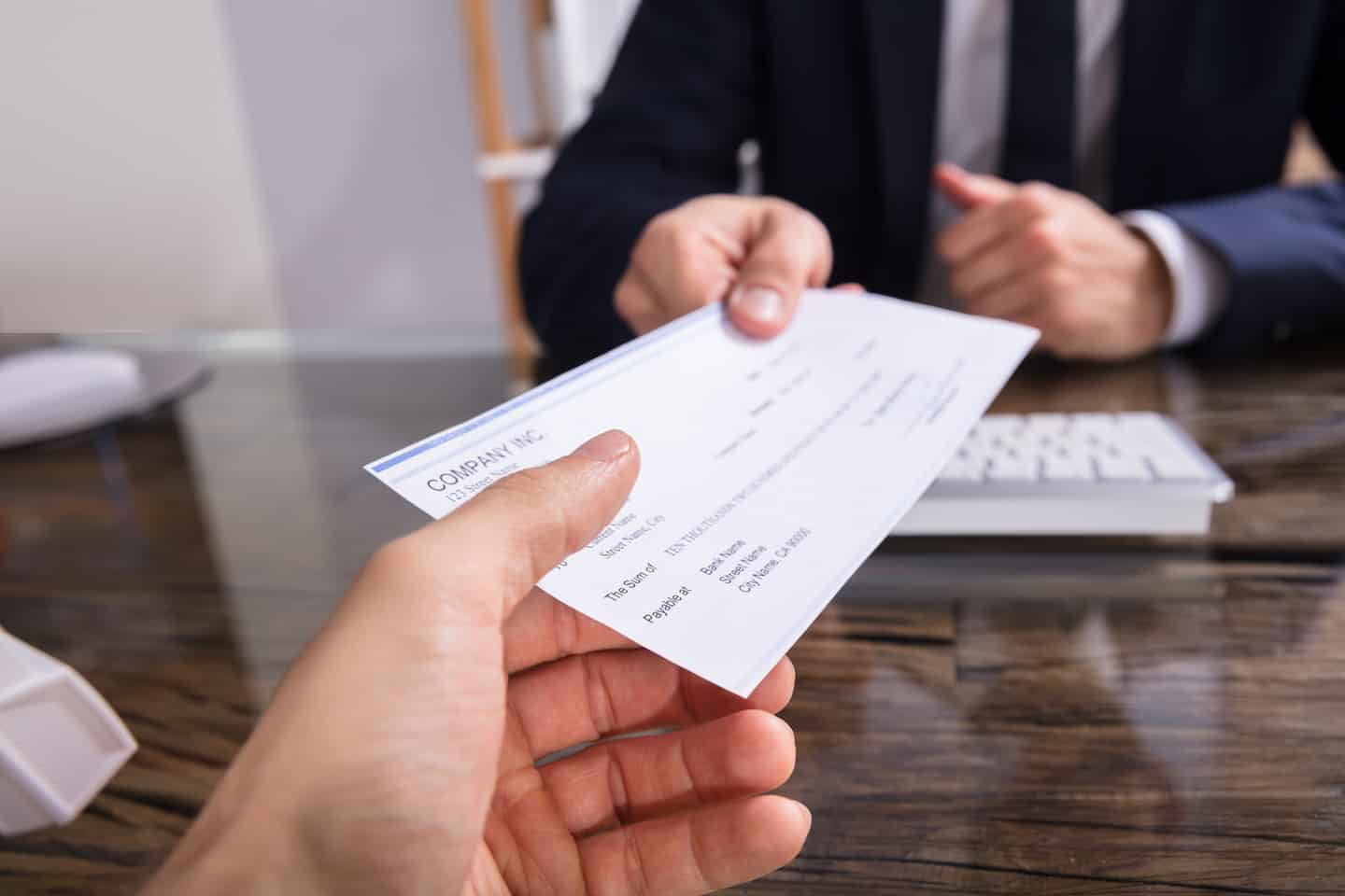 7 Best Places to Cash a Check (Low Fees and Without a Bank