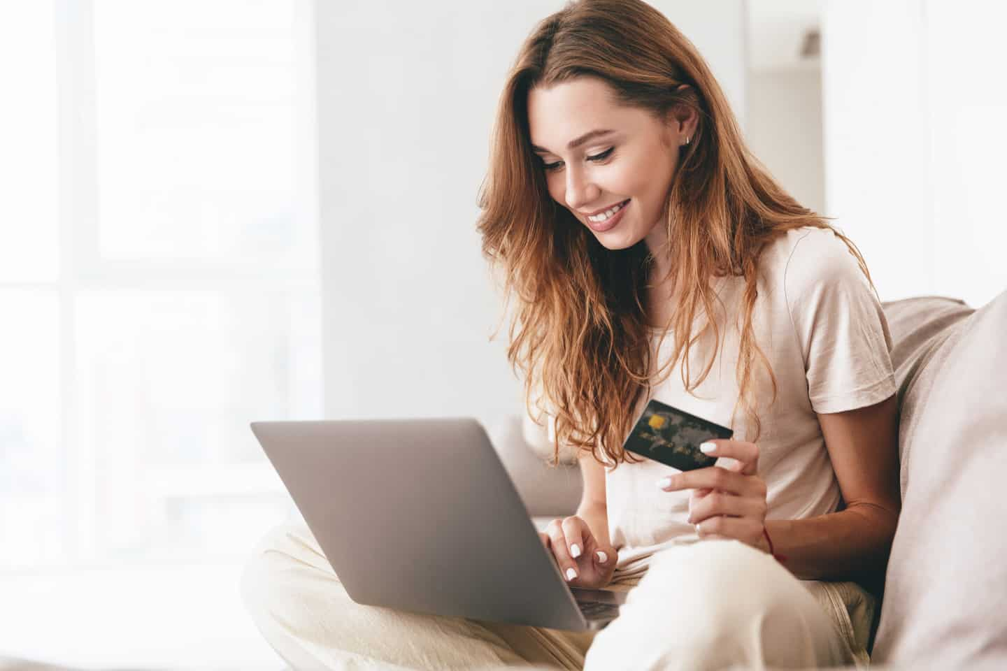 Woman Using American Express Personal Savings Account on Laptop