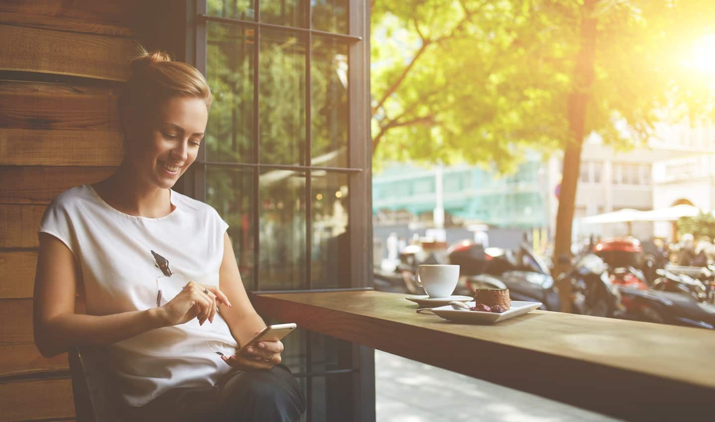 woman using phone to research how to improve your credit score