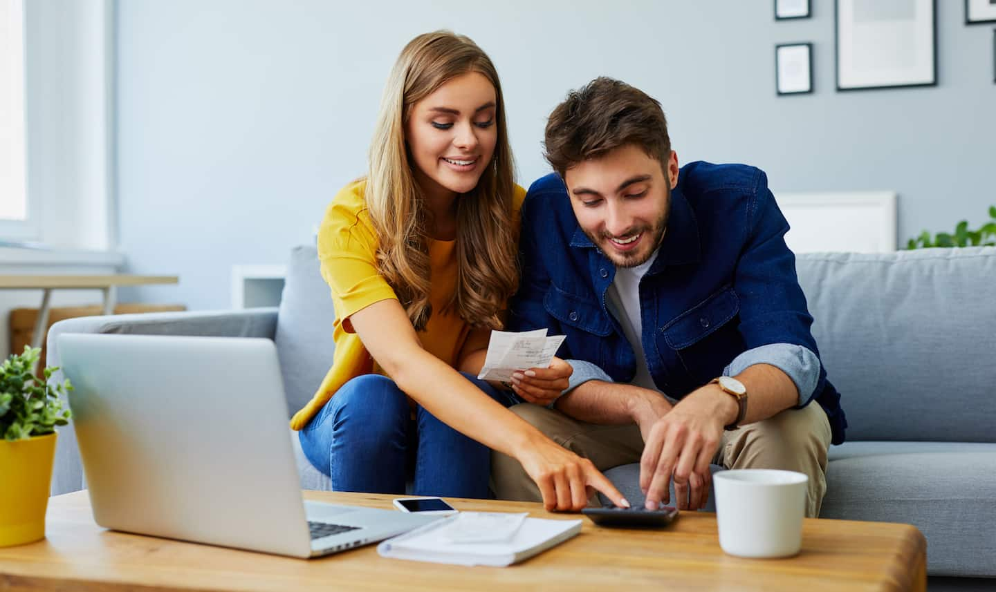 couple discussing frugal living and budgeting