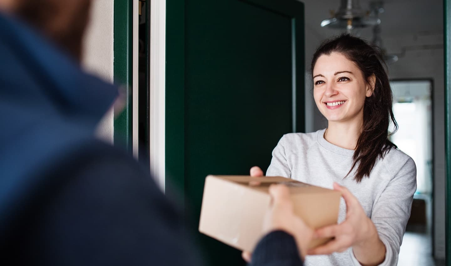 girl smiling receiving a package