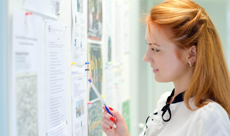 woman looking at a job board