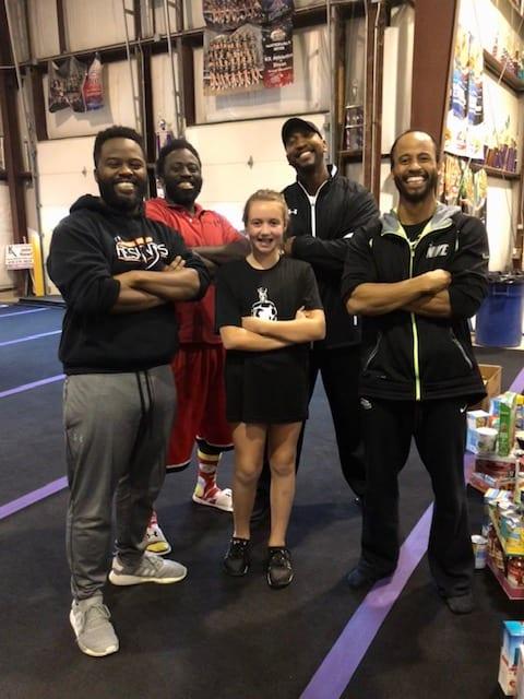 cheerleading coaches posing for photo