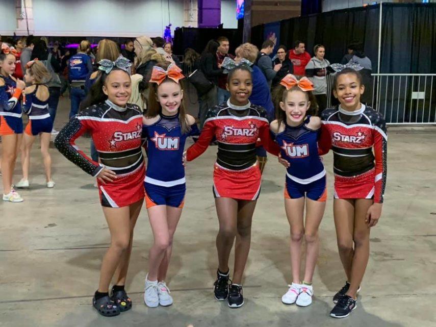young cheerleaders smiling