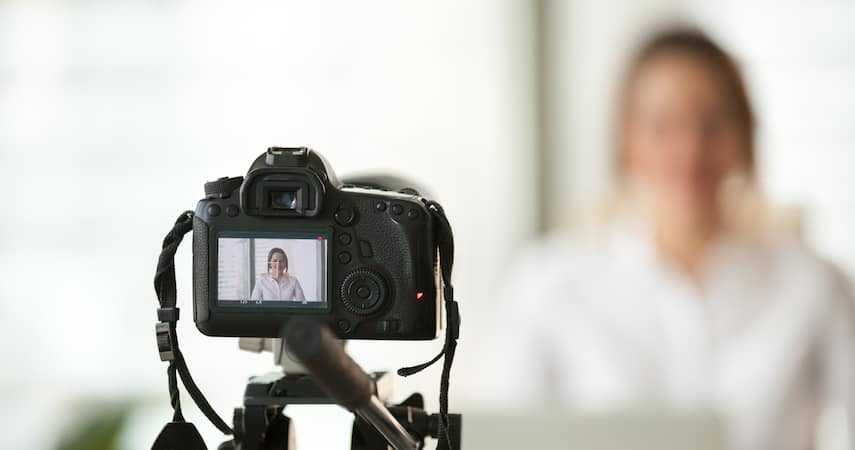 woman filming online course fizkes