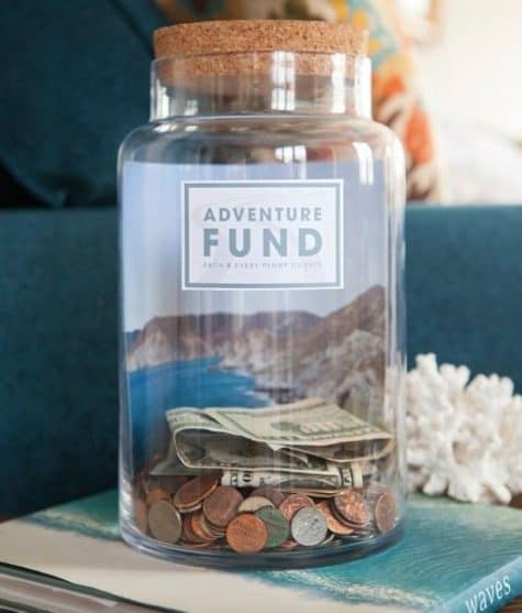 Adventure fund change jar to save up for a yearly vacation