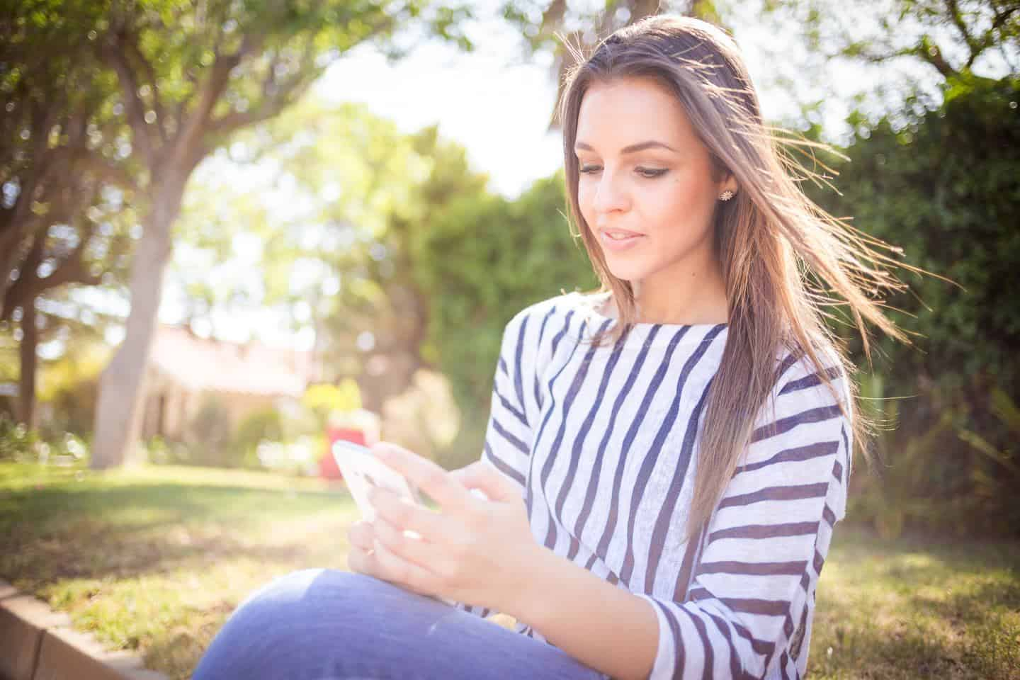 woman watching ads for money on her phone