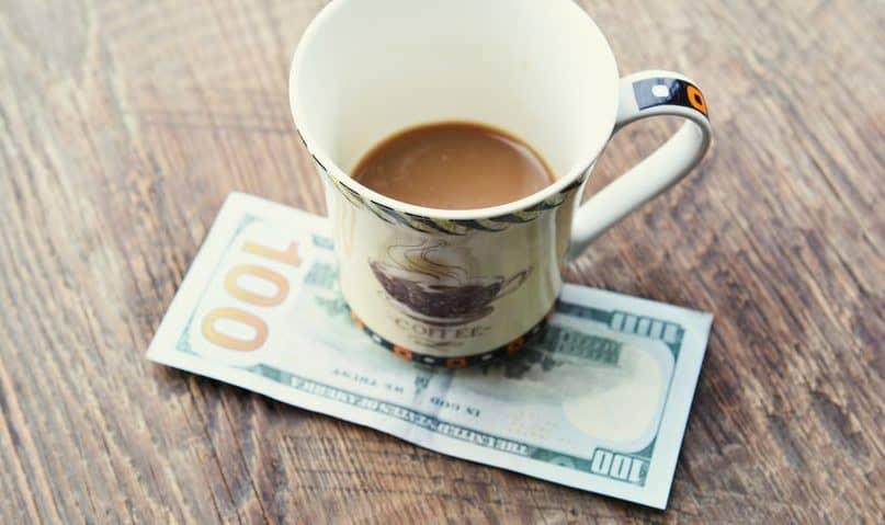 Other ways to get free money now. Coffee mug on table with 100 dollar bill